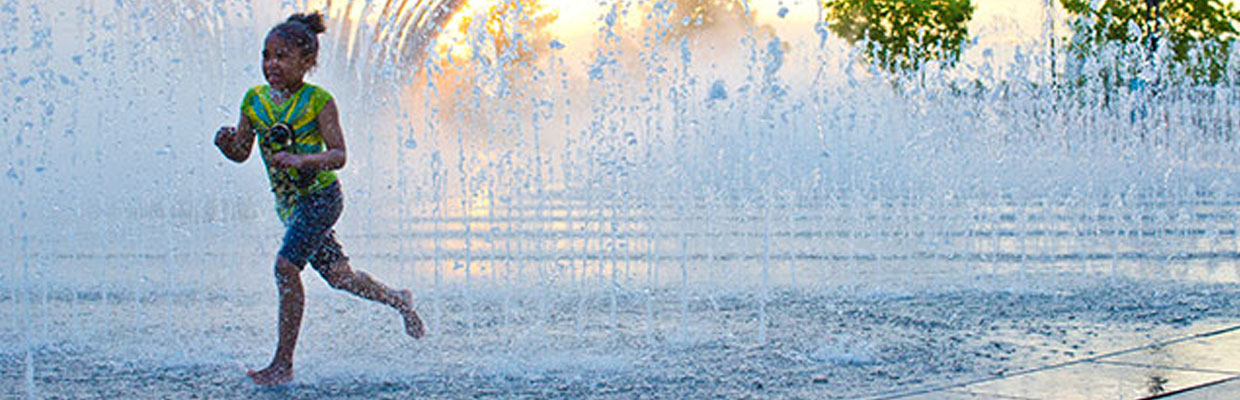 Girl playing in Scioto Mile fountain